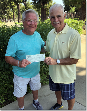 Alan Wissing presenting check to Gary Ovitt